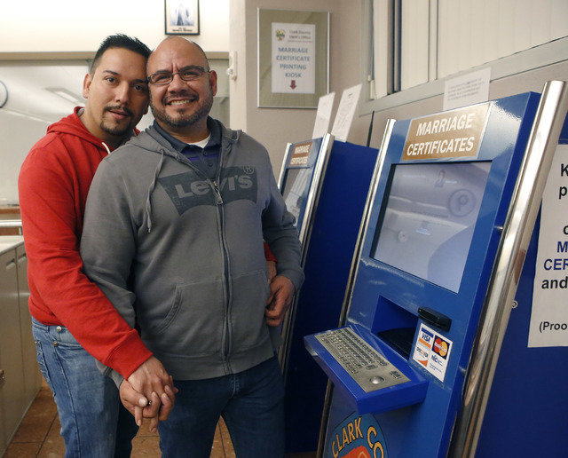 Raul Luna, 37, left, and Luis Zamarripa, 49, after purchasing their marriage certificate at the Clark County Marriage License Bureau on Tuesday, Feb. 21, 2017, in Las Vegas. An Assembly committee  ...