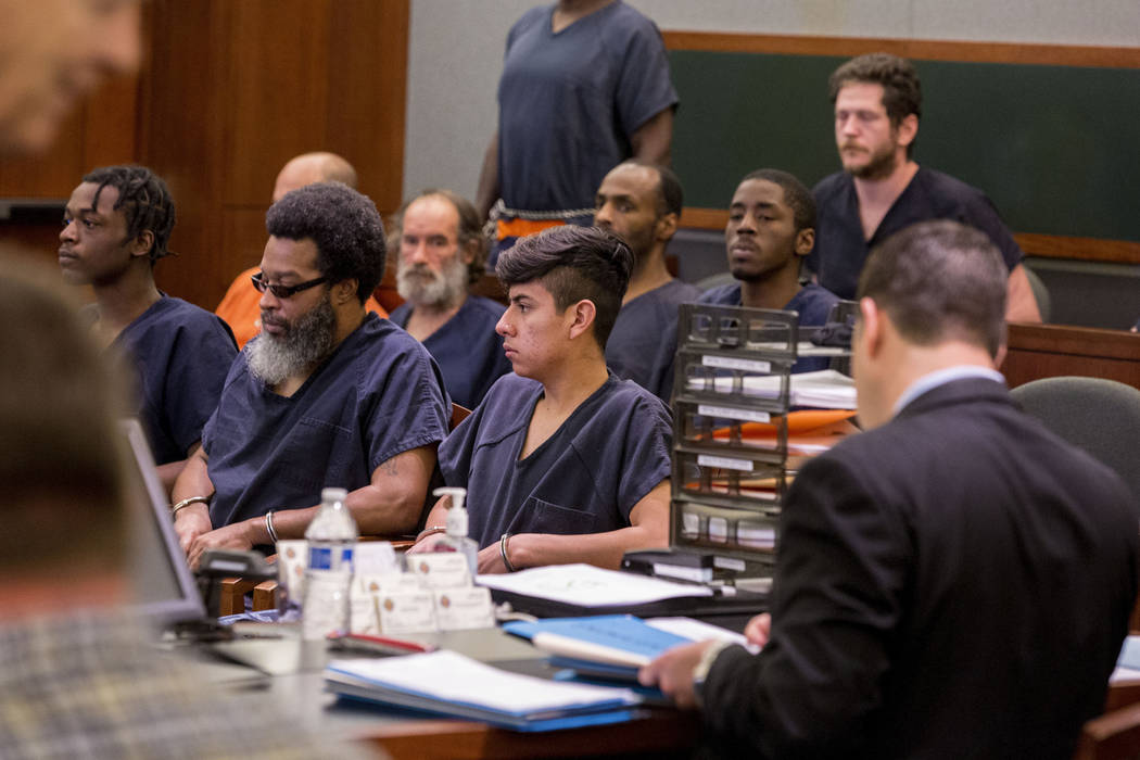 Mejia-Henriquez, 18, center, facing charges that include sexual assault against a child younger than 16, kidnapping and production of child pornography, during his court appearance at the Regional ...