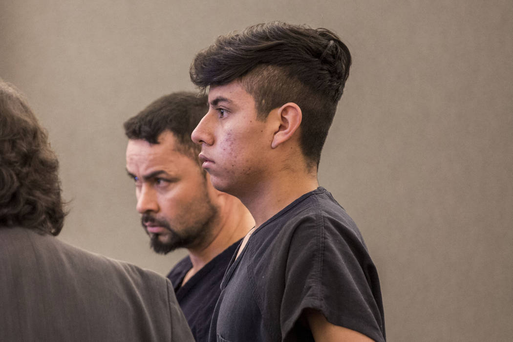 Leby Alas-Gomez, 39, left, and Jose Mejia-Henriquez, 18, charged for sexual assault of a 14-year-old special education student, during their court appearance at the Regional Justice Center in Las  ...