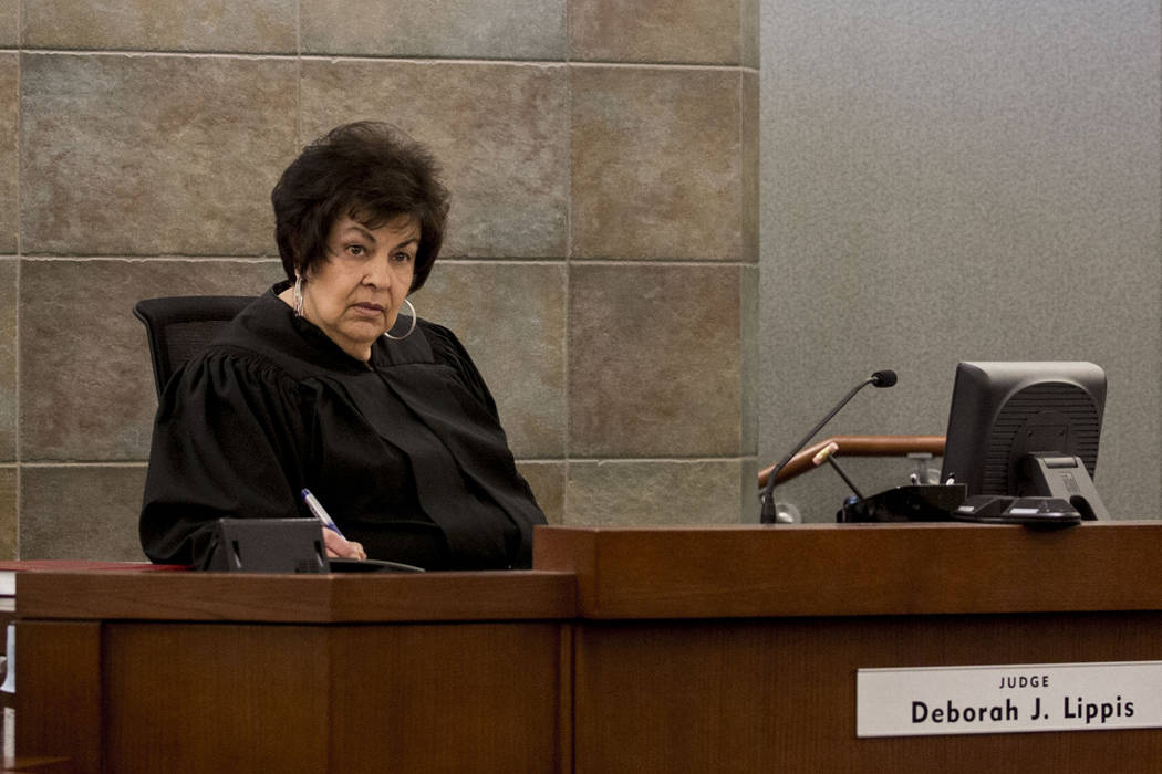 Judge Deborah J. Lippis speaks with attorneys during the court appearance for Leby Alas-Gomez, 39, and Jose Mejia-Henriquez, 18, charged for sexual assault of a 14-year-old special education stude ...