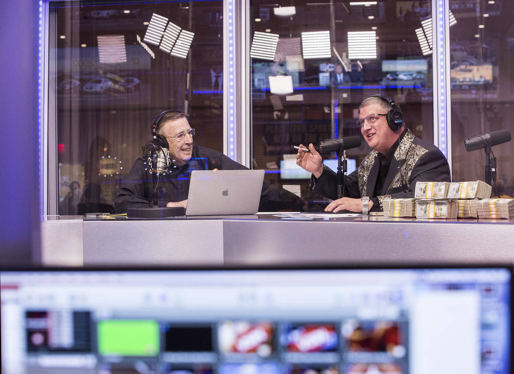 Brent Musburger, left, and Derek Stevens discuss opening round lines during a live broadcast covering the NCCA Tournament on the Vegas Stats & Information Network on Sunday, March 12, 2017, at ...