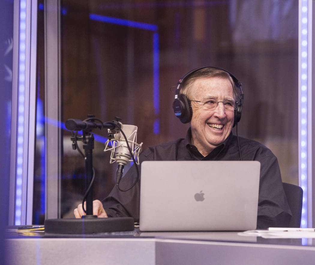 Brent Musburger shares a laugh with staff members  during a live broadcast covering opening round NCCA Tournament odds on the Vegas Stats & Information Network on Sunday, March 12, 2017, at So ...