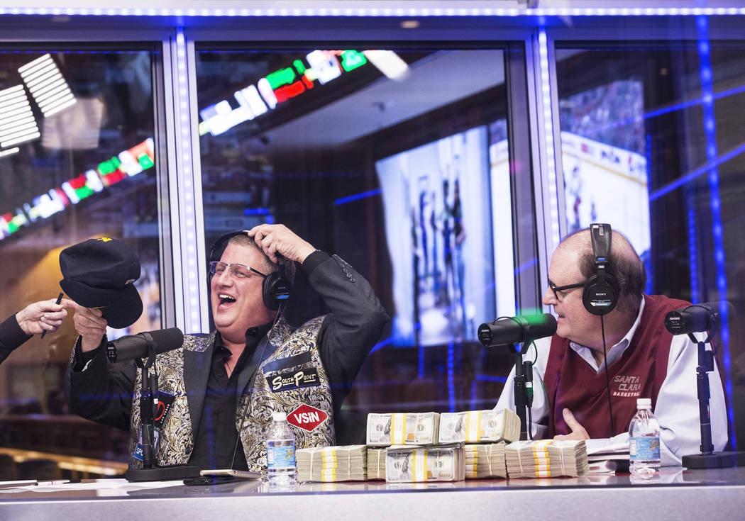 Derek Stevens, left, owner of the D Las Vegas hotel-casino, and handicapper Bruce Marshall joke around as opening round lines come in during a live broadcast covering the NCCA Tournament on the Ve ...