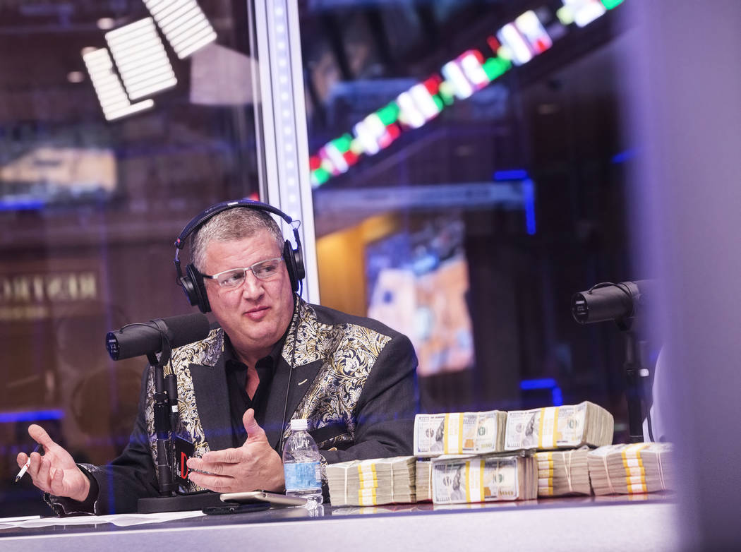 Derek Stevens, owner of the D Las Vegas hotel-casino, discusses opening round lines during a live broadcast covering the NCCA Tournament on the Vegas Stats & Information Network on Sunday, Mar ...