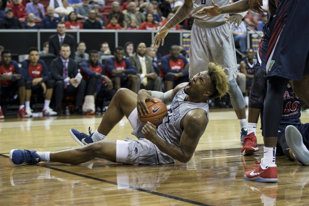 Nevada Wolf Pack guard Jordan Caroline (24) takes a foul against Fresno State Bulldogs in the Mountain West tournament semifinal at the Thomas & Mack Center on Friday, March 10, 2017, in Las V ...