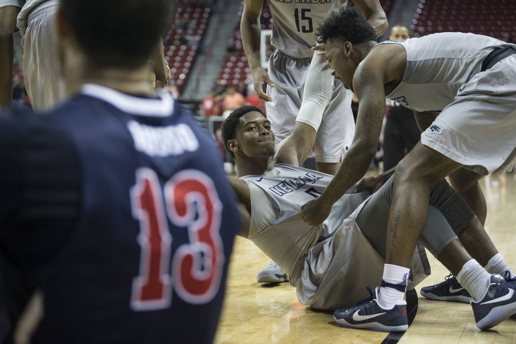 Nevada Wolf Pack forward Cameron Oliver (0) stands after getting fouled while making a three-point shot against Fresno State Bulldogs in the Mountain West tournament semifinal at the Thomas &  ...
