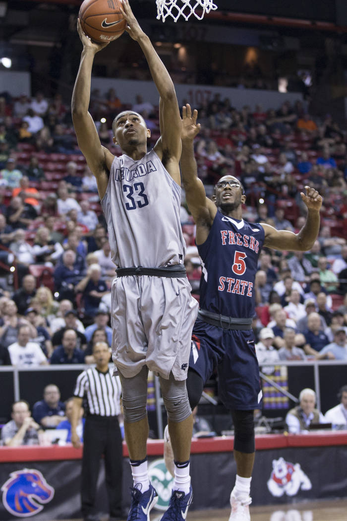 Nevada Wolf Pack guard Josh Hall (33) goes up for a shot against Fresno State Bulldogs in the Mountain West tournament semifinal at the Thomas & Mack Center on Friday, March 10, 2017, in Las V ...