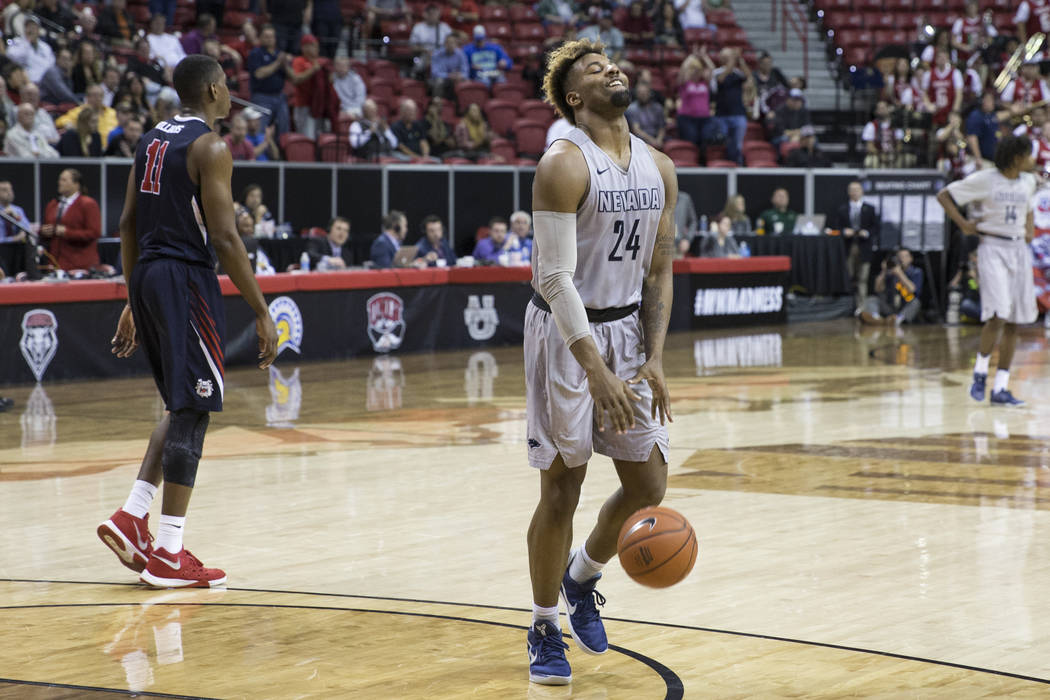 Nevada Wolf Pack guard Jordan Caroline (24) reacts at the end of the game against Fresno State Bulldogs in the Mountain West tournament semifinal at the Thomas & Mack Center on Friday, March 1 ...