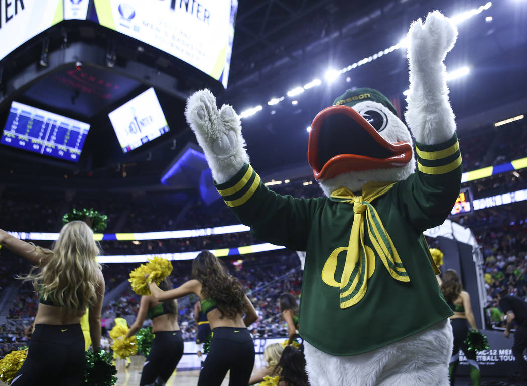 The Oregon Duck cheers during the Pac-12 Conference basketball tournament semifinal game between Oregon and California at the T-Mobile Arena in Las Vegas on Friday, March 10, 2017. (Chase Stevens/ ...