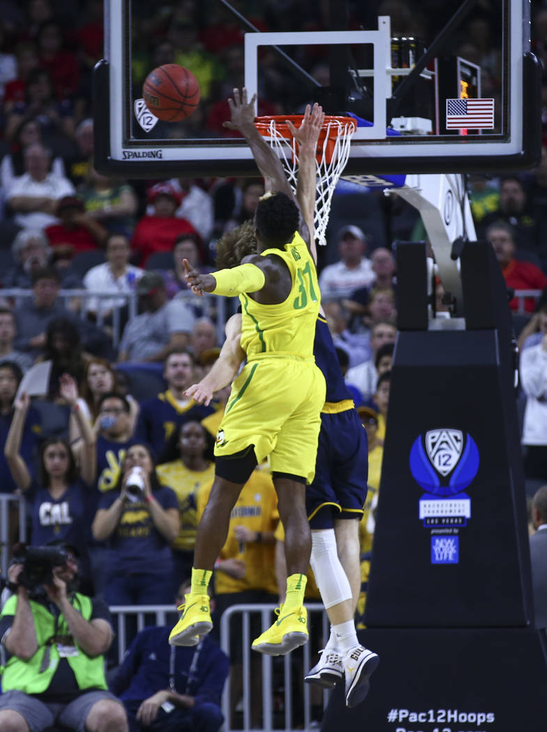Oregon guard Dylan Ennis (31) blocks a shot from California guard Grant Mullins (3) during the Pac-12 Conference basketball tournament semifinals at the T-Mobile Arena in Las Vegas on Friday, Marc ...