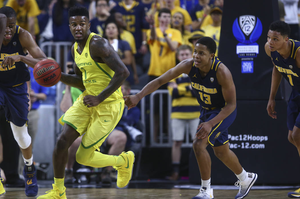 Oregon forward Jordan Bell (1) drives against California guard Charlie Moore (13) during the Pac-12 Conference basketball tournament semifinals at the T-Mobile Arena in Las Vegas on Friday, March  ...