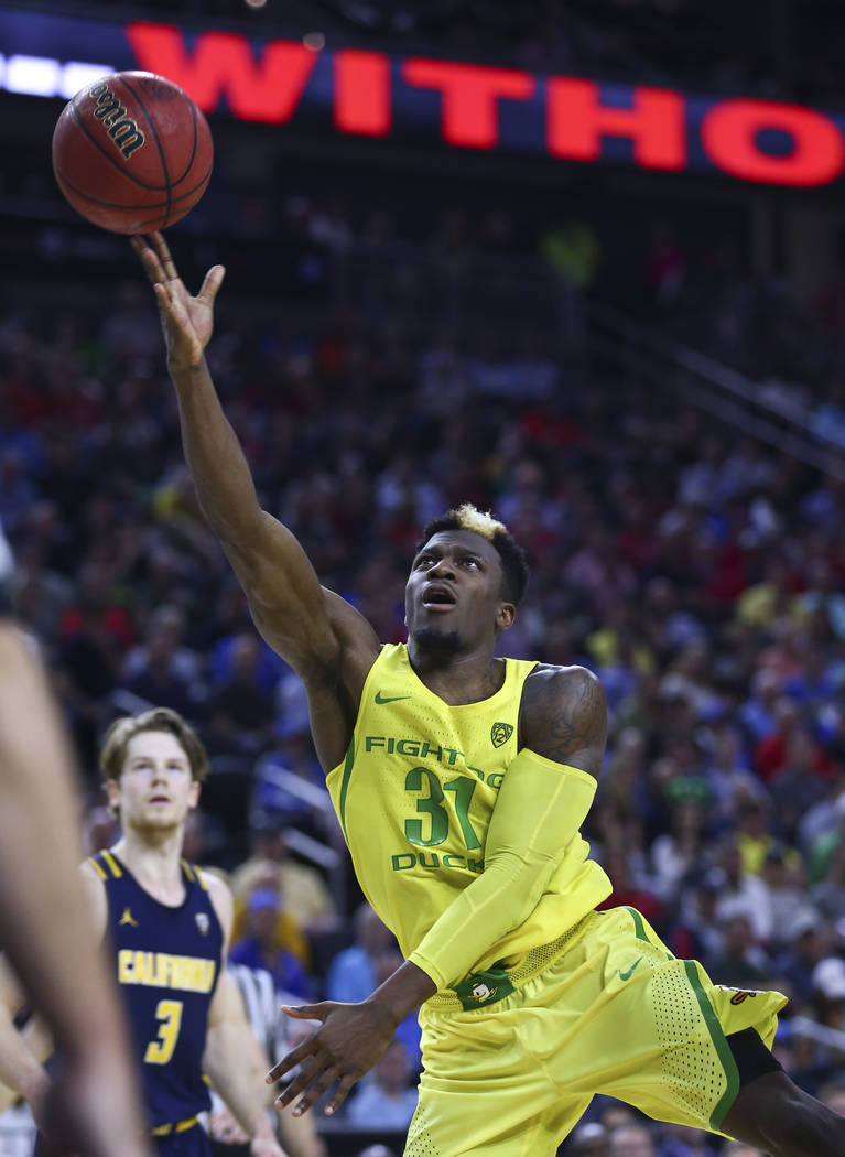 Oregon guard Dylan Ennis (31) shoots against California during the Pac-12 Conference basketball tournament semifinals at the T-Mobile Arena in Las Vegas on Friday, March 10, 2017. Oregon defeated  ...
