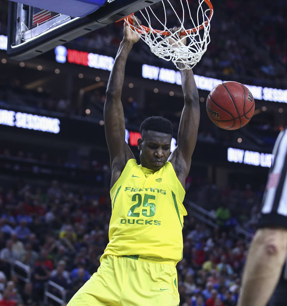 Oregon forward Chris Boucher (25) dunks against California during the Pac-12 Conference basketball tournament semifinals at the T-Mobile Arena in Las Vegas on Friday, March 10, 2017. Oregon defeat ...