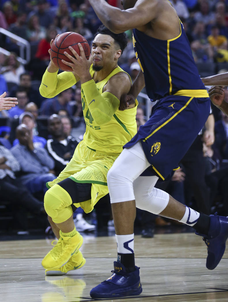 Oregon forward Dillon Brooks (24) drives against California during the Pac-12 Conference basketball tournament semifinals at the T-Mobile Arena in Las Vegas on Friday, March 10, 2017. Oregon defea ...