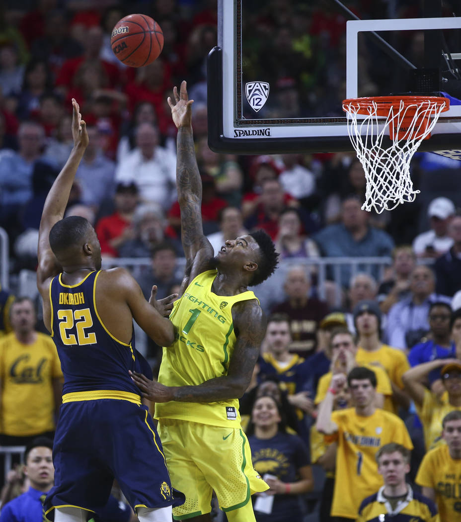 California center Kingsley Okoroh (22) shoots over Oregon forward Jordan Bell (1) during the Pac-12 Conference basketball tournament semifinals at the T-Mobile Arena in Las Vegas on Friday, March  ...