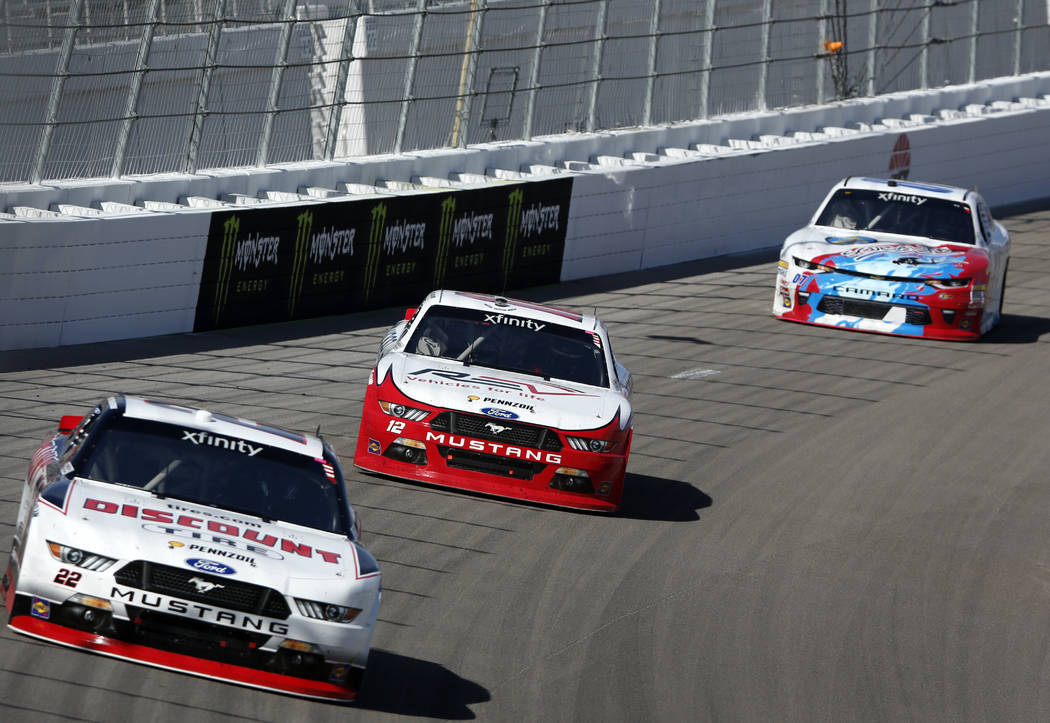 Joey Logano, center, races with Brad Keselowski, left, and Ray Black Jr. during the Boyd Gaming 300, a NASCAR Xfinity Series auto race, at the Las Vegas Motor Speedway Saturday, March 11, 2017, in ...