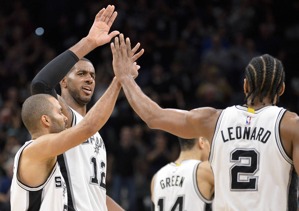 San Antonio Spurs' LaMarcus Aldridge (12) and Tony Parker, of France, congratulate Spurs forward Kawhi Leonard (2) after his go-ahead 3-point basket with less than 30 seconds left in the fourth qu ...