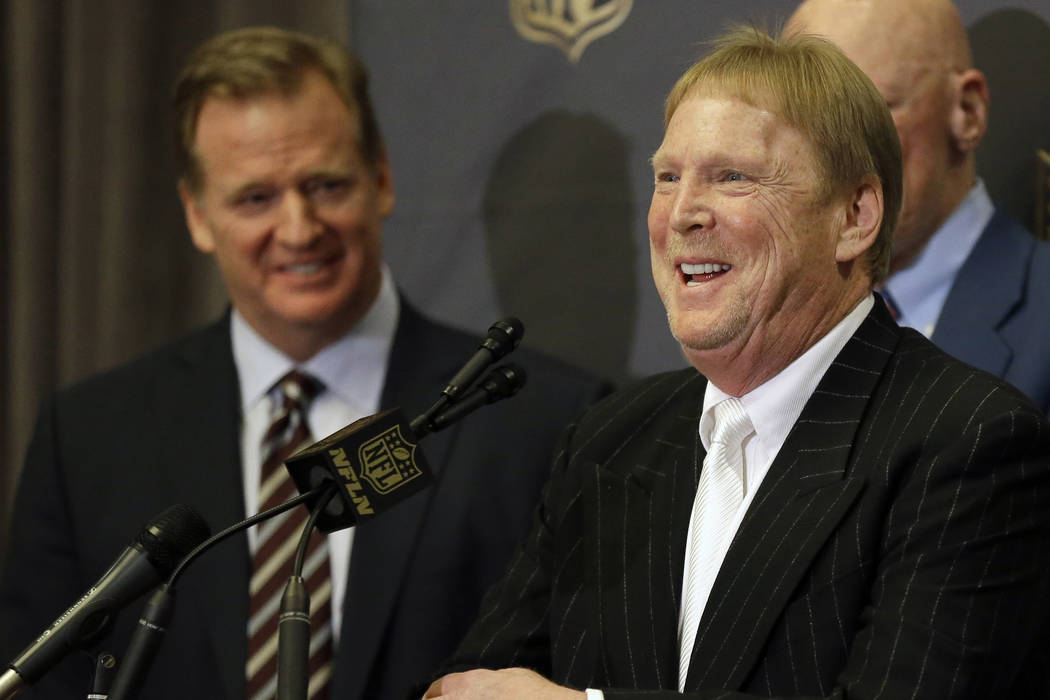 FILE - In this Jan. 12, 2016, file photo, NFL Commissioner Roger Goodell, left, laughs as Oakland Raiders owner Mark Davis talks to the media after an NFL owners meeting in Houston.  The Raiders h ...