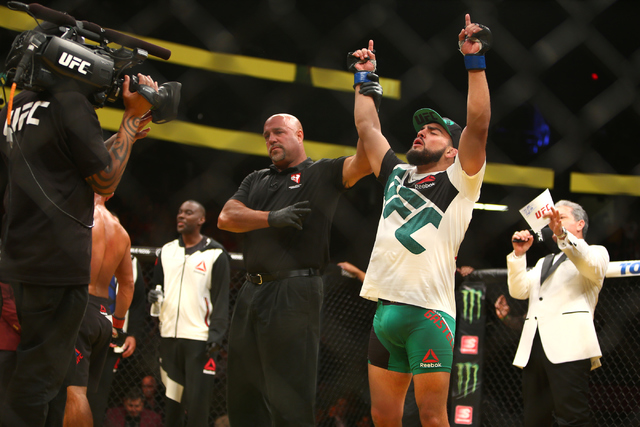 Kelvin Gastelum celebrates after defeating Johnny Hendricks during their welterweight fight UFC 200 at T-Mobile Arena in Las Vegas on Saturday, July 9, 2016. (Loren Townsley/Las Vegas Review-Journ ...