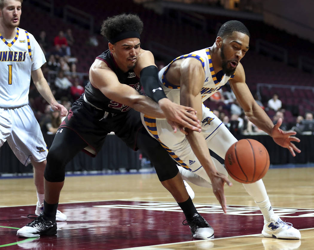 New Mexico State forward Eli Chuha, front left, reaches for a loose ball with Cal State Bakersfield forward Jaylin Airington during the second half of an NCAA college basketball game in the final  ...