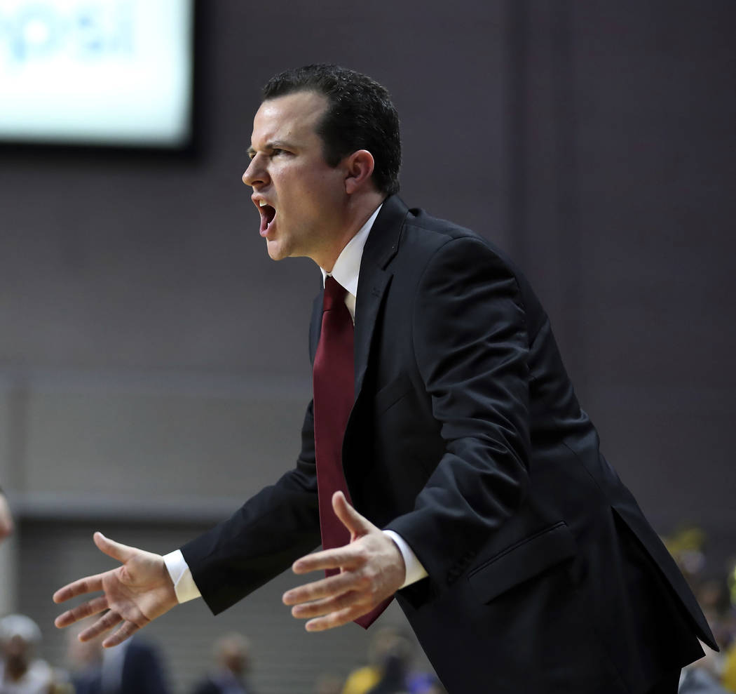 New Mexico State coach Paul Weir yells to his team during the second half of an NCAA college basketball game against Cal State Bakersfield in the final of the Western Athletic Conference tournamen ...