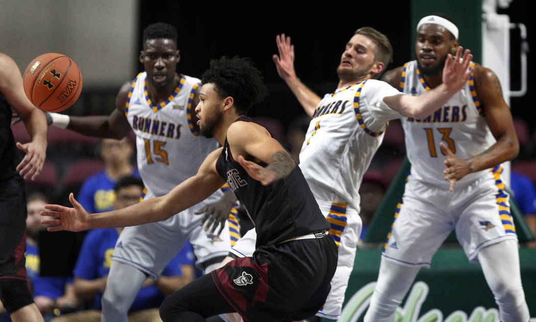 New Mexico State guard Jermaine Haley (1) eyes a loose ball after colliding with Cal State Bakersfield guard Brent Wrapp (1) during the first half of an NCAA college basketball game in the final o ...