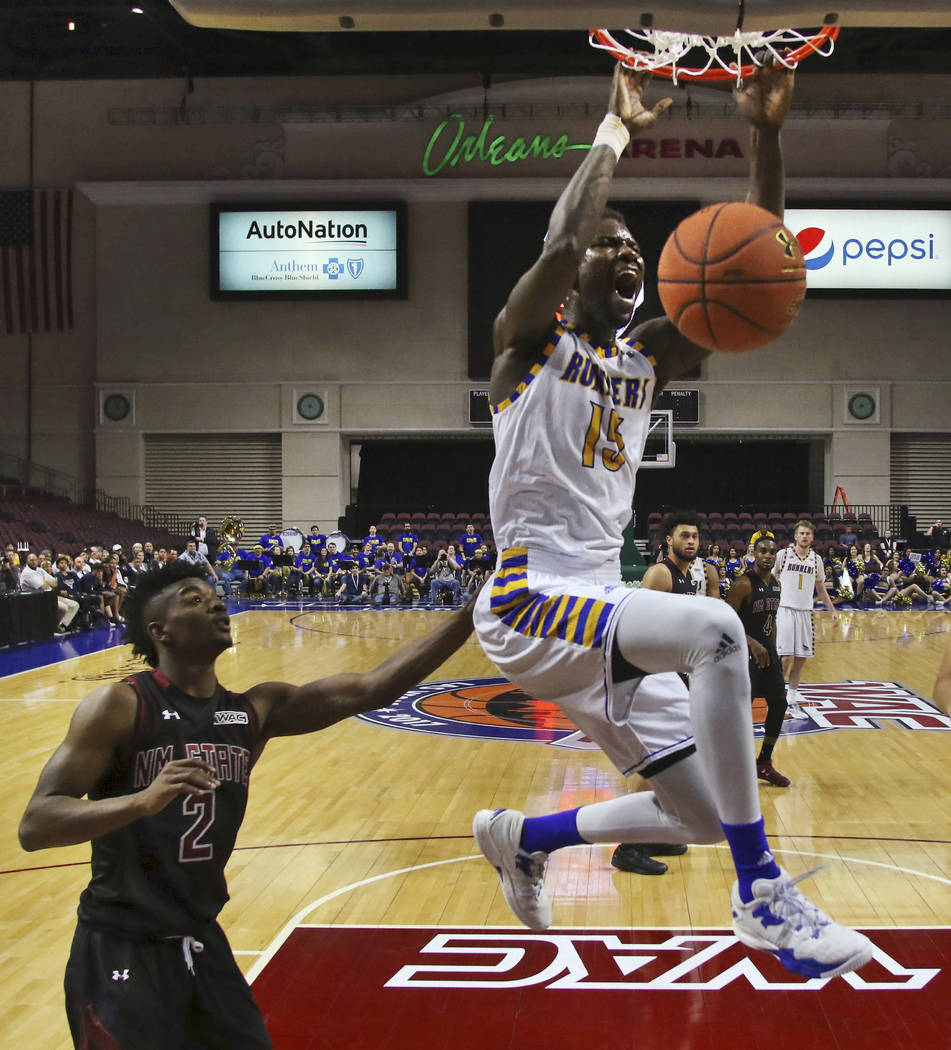Cal State Bakersfield center Fallou Ndoye (15) dunks on a fast break in front of New Mexico State guard Braxton Huggins (2) during the second half of an NCAA college basketball game in the final o ...