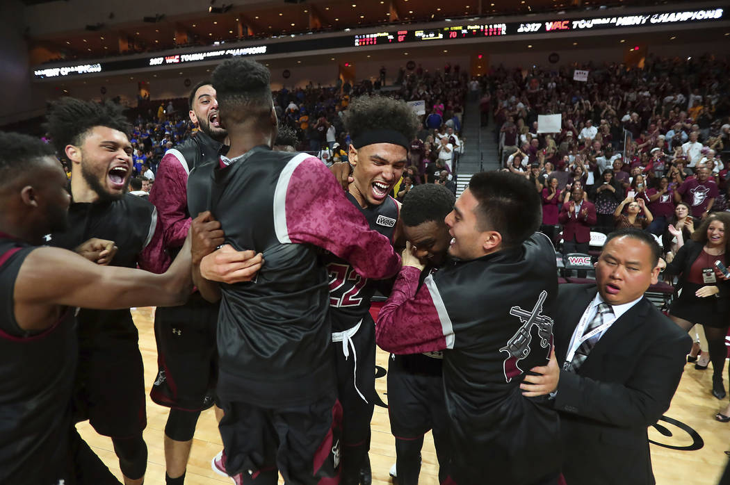 New Mexico State players celebrate their victory over Cal State Bakersfield in an NCAA college basketball game during the final of the Western Athletic Conference tournament Saturday, March 11, 20 ...