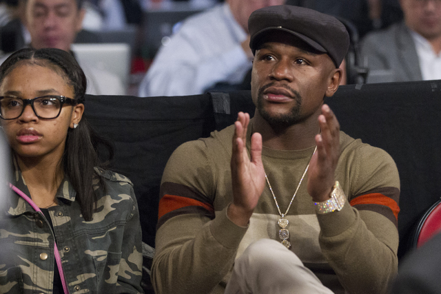 Floyd Mayweather Jr. sits ring side with his daughter Iyanna for the main event fight between Manny Pacquiao and Jessie Vargas at the Thomas & Mack Center on Saturday, Nov. 5, 2016, in Las Veg ...