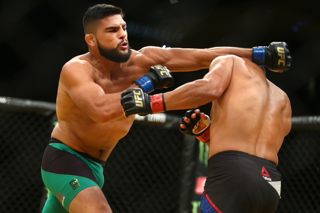 Kelvin Gastelum lands a strike against Johnny Hendricksduring their welterweight fight at UFC 200 at T-Mobile Arena in Las Vegas on Saturday, July 9, 2016. (Loren Townsley/Las Vegas Review-Journal)
