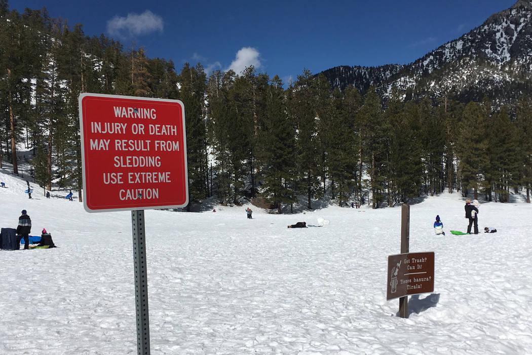 A warning sign is displayed near a sledding hill at Mount Charleston on Sunday, Feb. 27, 2017. (Ashley Casper/Las Vegas Review-Journal) @TheCasperA