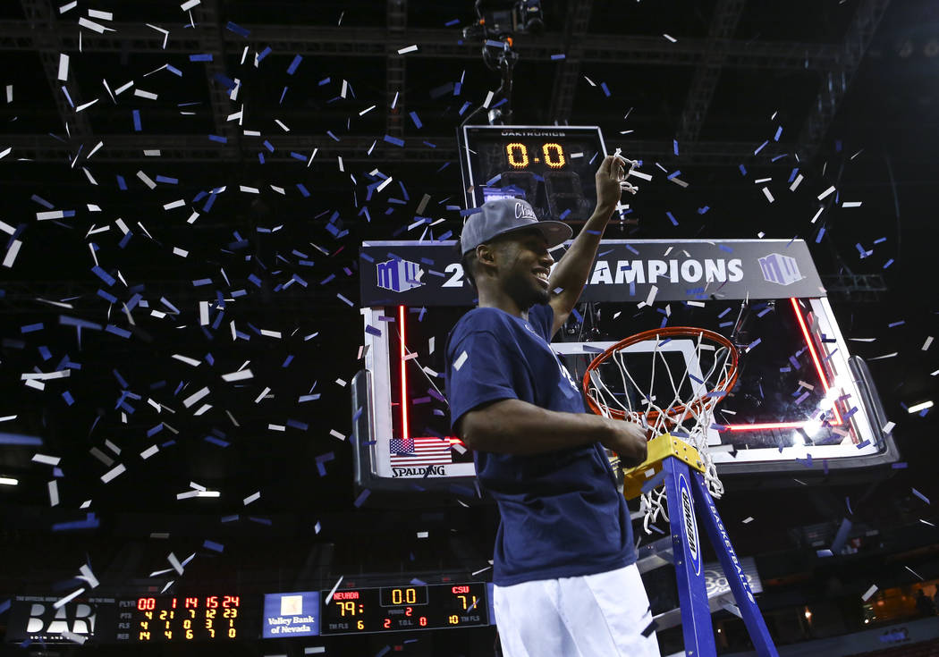 UNR guard D.J. Fenner (15) holds up a piece of the net after defeating Colorado State 79-71 in the Mountain West Conference basketball championship game at the Thomas & Mack Center in Las Vega ...