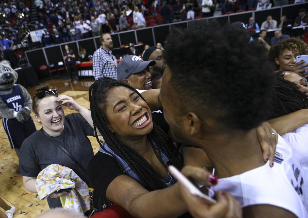 Erika Fenner celebrates with her brother, UNR guard D.J. Fenner (15), during the Mountain West Conference basketball championship game at the Thomas & Mack Center in Las Vegas on Saturday, Mar ...
