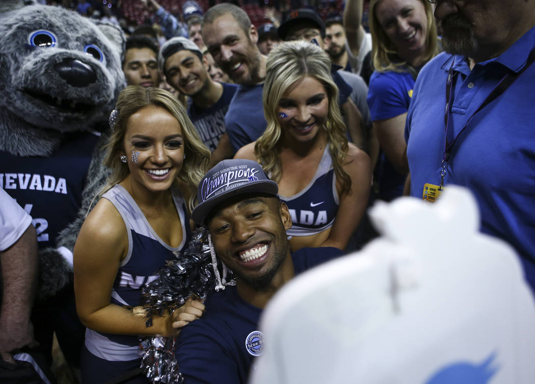 UNR guard D.J. Fenner (15) takes a selfie with cheerleaders and fans during the Mountain West Conference basketball championship game at the Thomas & Mack Center in Las Vegas on Saturday, Marc ...