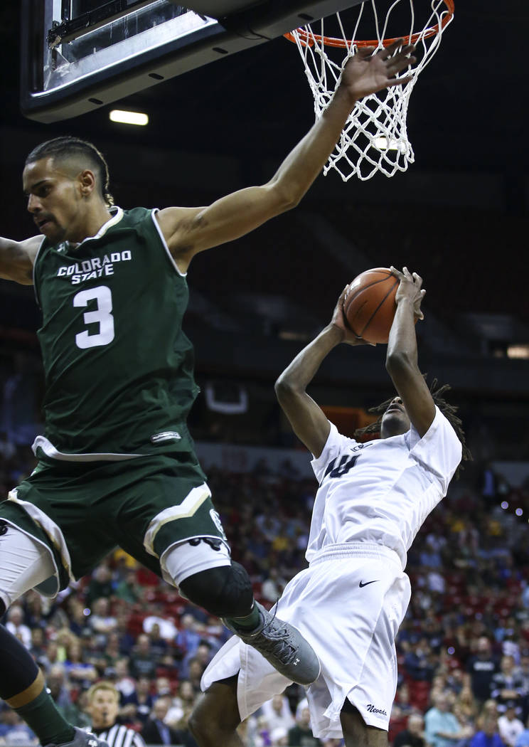 UNR forward Caleb Martin (10) goes to the basket against Colorado State during the Mountain West Conference basketball championship game at the Thomas & Mack Center in Las Vegas on Saturday, M ...