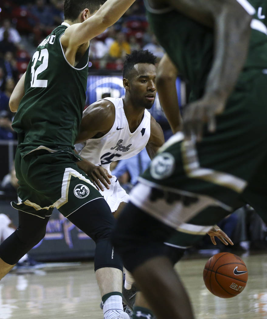 UNR guard D.J. Fenner (15) drives to the basket against Colorado State forward Nico Carvacho (32) during the Mountain West Conference basketball championship game at the Thomas & Mack Center i ...
