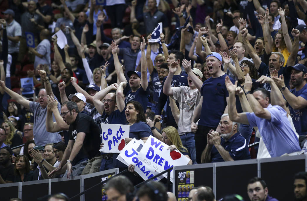 UNR fans celebrate as their team plays Colorado State during the Mountain West Conference basketball championship game at the Thomas & Mack Center in Las Vegas on Saturday, March 11, 2017. (Ch ...