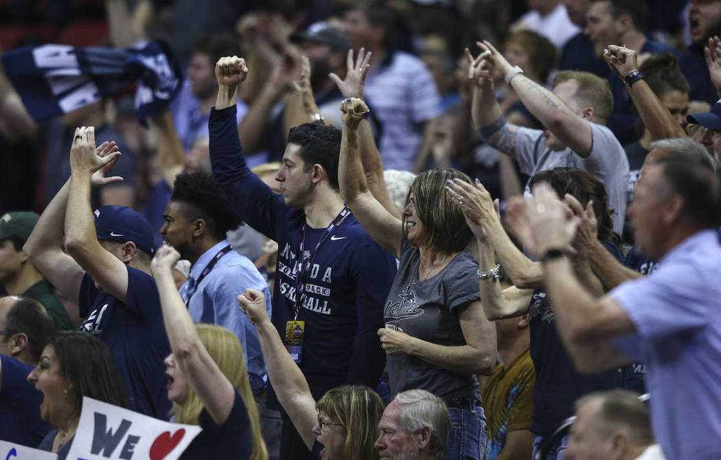 UNR fans celebrate as their team plays Colorado State during the Mountain West Conference basketball championship game at the Thomas & Mack Center in Las Vegas on Saturday, March 11, 2017. UNR ...