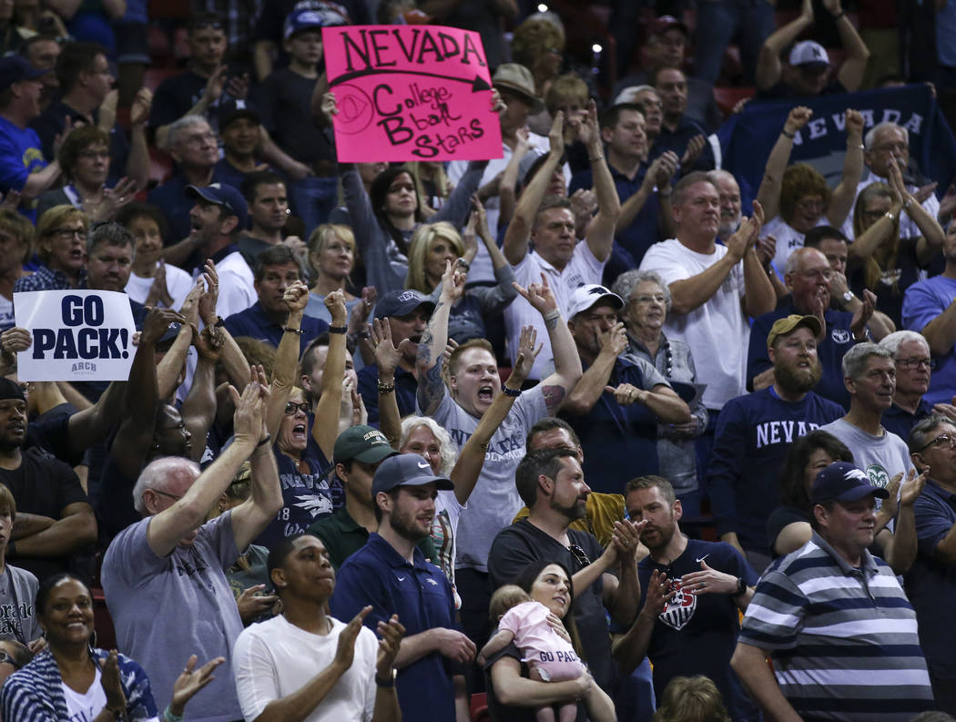 UNR fans celebrate as their team defeats Colorado State 79-71 in the Mountain West Conference basketball championship game at the Thomas & Mack Center in Las Vegas on Saturday, March 11, 2017. ...
