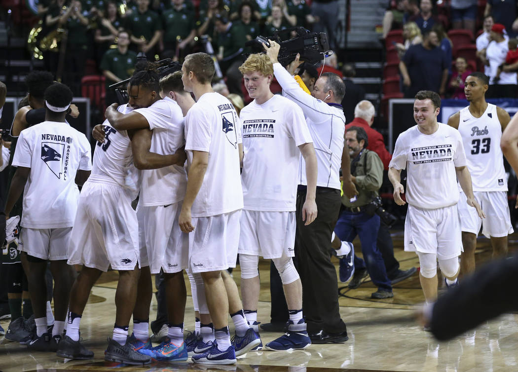 UNR players celebrate after defeating Colorado State 79-71 in the Mountain West Conference basketball championship game at the Thomas & Mack Center in Las Vegas on Saturday, March 11, 2017. (C ...