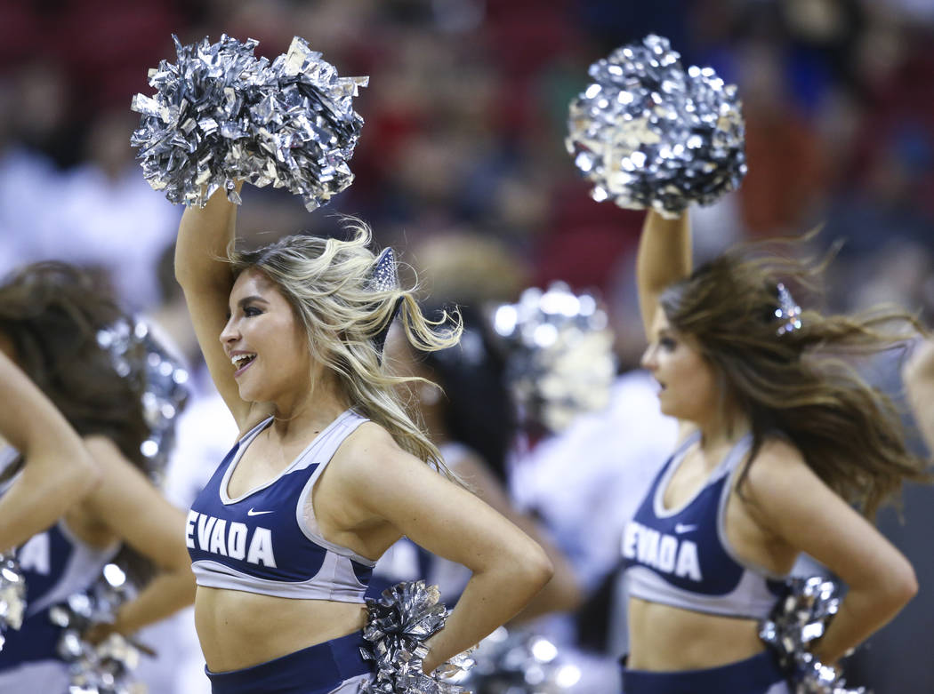 UNR cheerleaders perform during the Mountain West Conference basketball championship game at the Thomas & Mack Center in Las Vegas on Saturday, March 11, 2017. UNR defeated Colorado State 79-7 ...