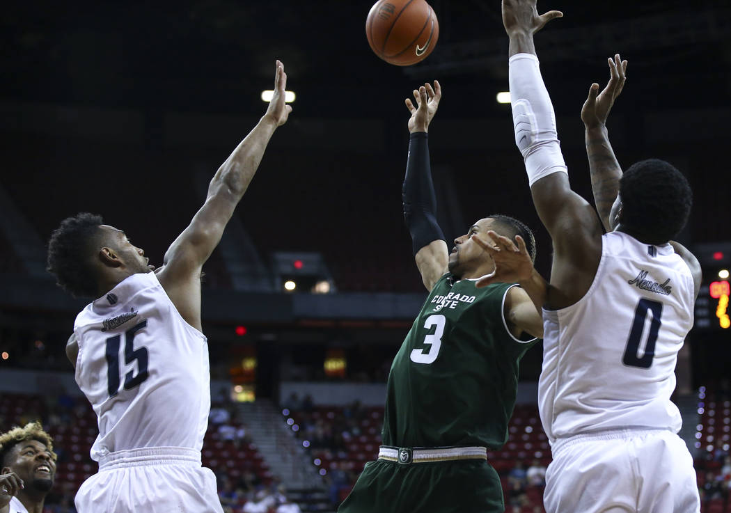 Colorado State guard Gian Clavell (3) shoots between UNR guard D.J. Fenner (15) and UNR forward Cameron Oliver (0) during the Mountain West Conference basketball championship game at the Thomas &a ...
