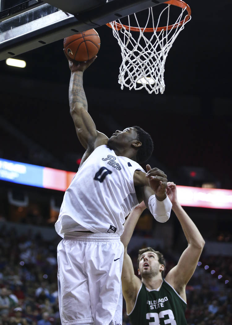 UNR forward Cameron Oliver (0) gets a rebound over Colorado State forward Braden Koelliker (33) during the Mountain West Conference basketball championship game at the Thomas & Mack Center in  ...