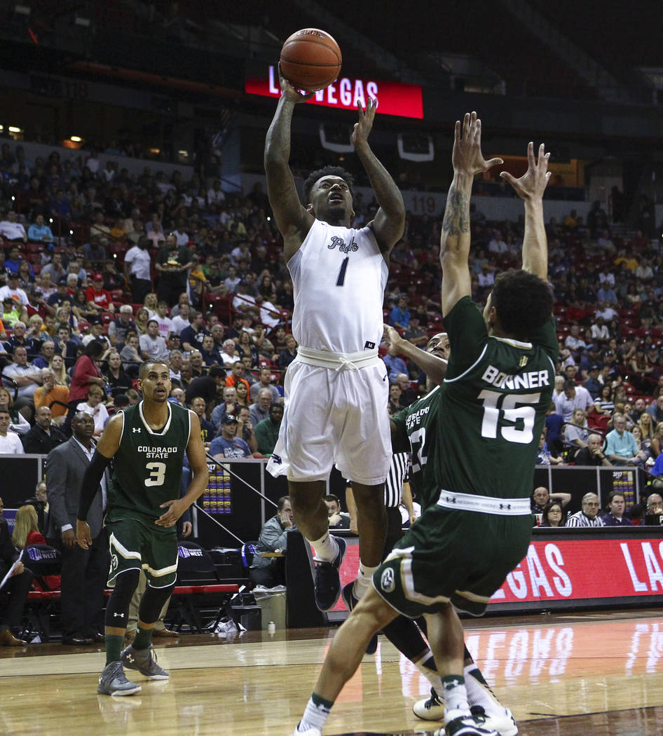 UNR guard Marcus Marshall (1) goes to the basket against  Colorado State guard Anthony Bonner (15) during the Mountain West Conference basketball championship game at the Thomas & Mack Center  ...