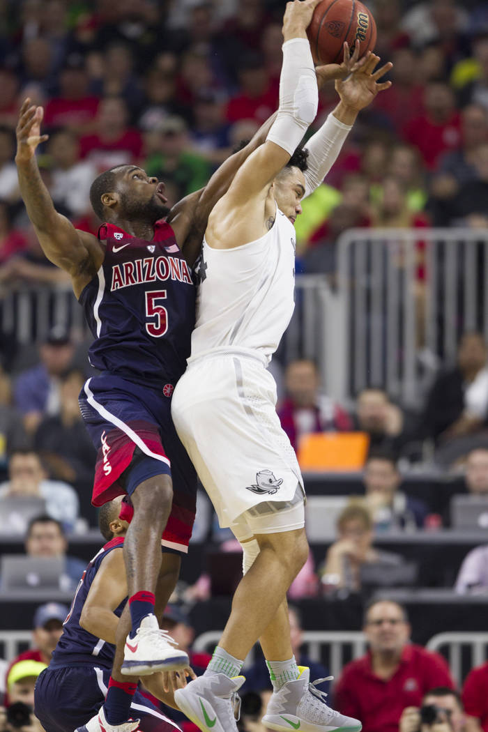Arizona Wildcats guard Kadeem Allen (5) and Oregon Ducks forward Dillon Brooks (24) fight for the ball in an NCAA college basketball game for the Pac-12 tournament championship at T-Mobile Arena S ...