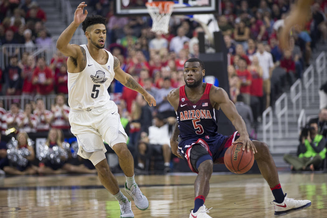 Arizona Wildcats guard Kadeem Allen (5) moves the ball against Oregon Ducks guard Tyler Dorsey (5) in an NCAA college basketball game for the Pac-12 tournament championship at T-Mobile Arena Satur ...