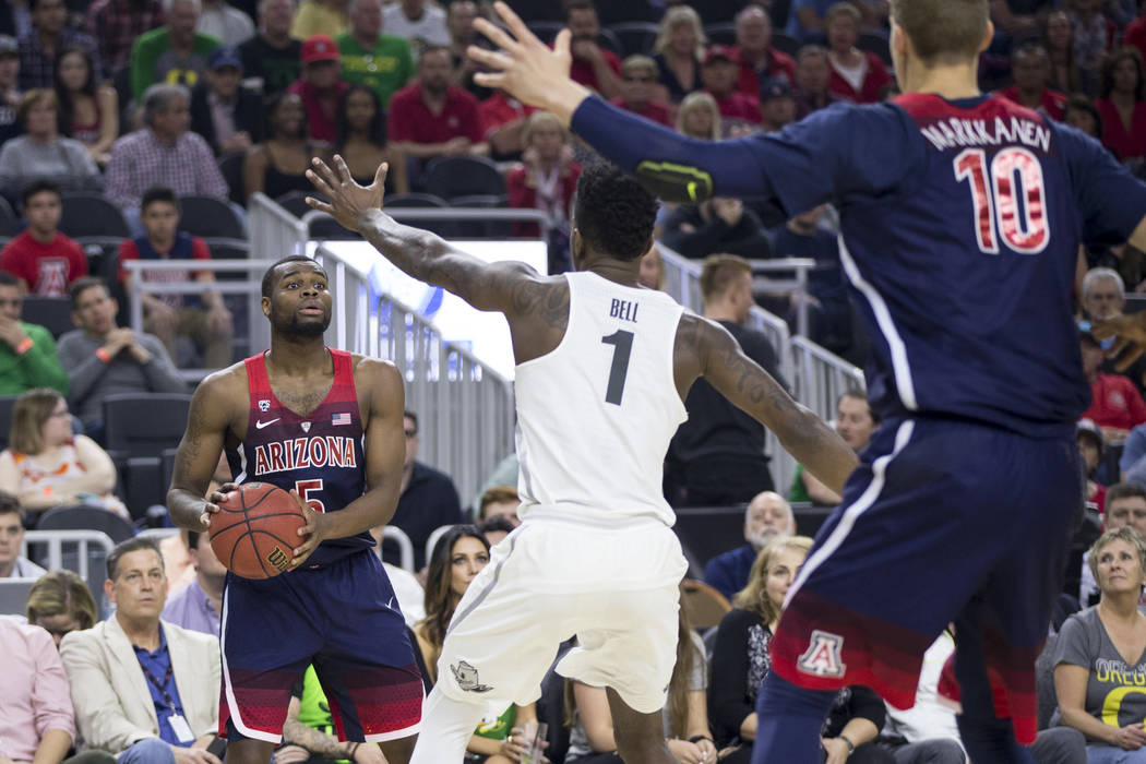 Arizona Wildcats guard Kadeem Allen (5) looks for an open pass against Oregon Ducks in an NCAA college basketball game for the Pac-12 tournament championship at T-Mobile Arena Saturday, March 11,  ...