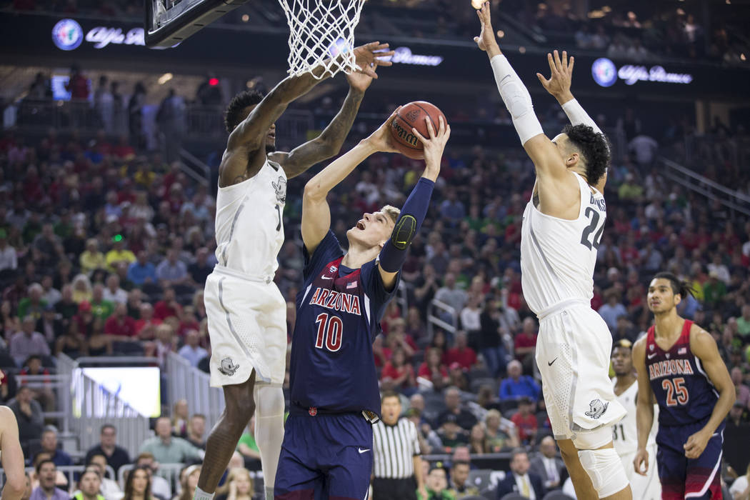 Arizona Wildcats forward Lauri Markkanen (10) goes up for a shot against Oregon Ducks in an NCAA college basketball game for the Pac-12 tournament championship at T-Mobile Arena Saturday, March 11 ...