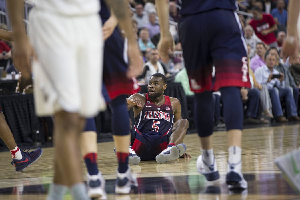 Arizona Wildcats guard Kadeem Allen (5) on the floor after getting fouled by the Oregon Ducks in an NCAA college basketball game for the Pac-12 tournament championship at T-Mobile Arena Saturday,  ...