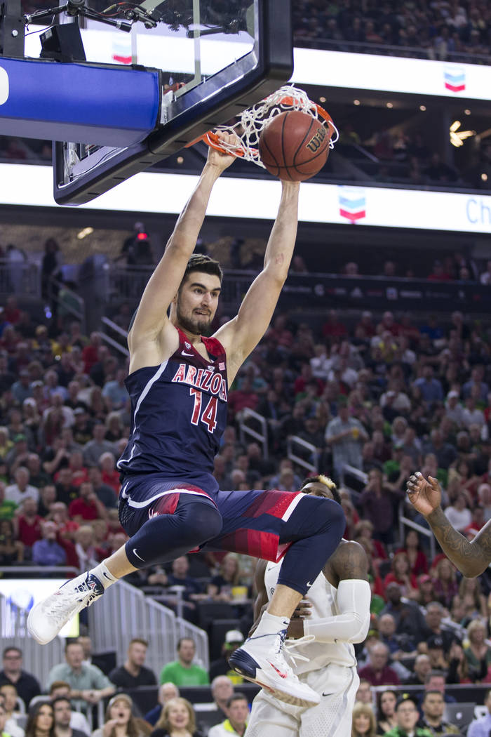 Arizona Wildcats center Dusan Ristic (14) dunks the ball against Oregon Ducks in an NCAA college basketball game for the Pac-12 tournament championship at T-Mobile Arena Saturday, March 11, 2017,  ...